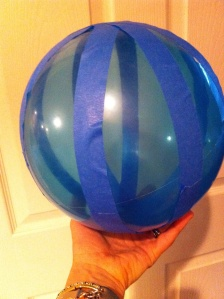 Blue balloon taped into stripes to illustrate time zones to children, Jet lag and KIDS, www.theeducationaltourist.com