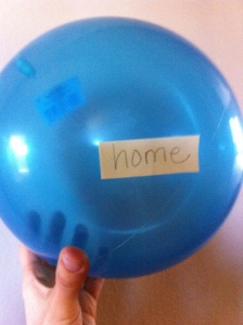 Blue balloon with the word home taped to it, Jet lag and KIDS, www.theeducationaltourist.com